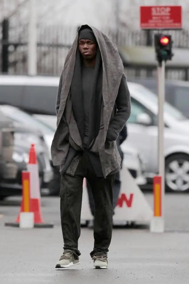 Paul Pogba walking in his eccentric fashion style