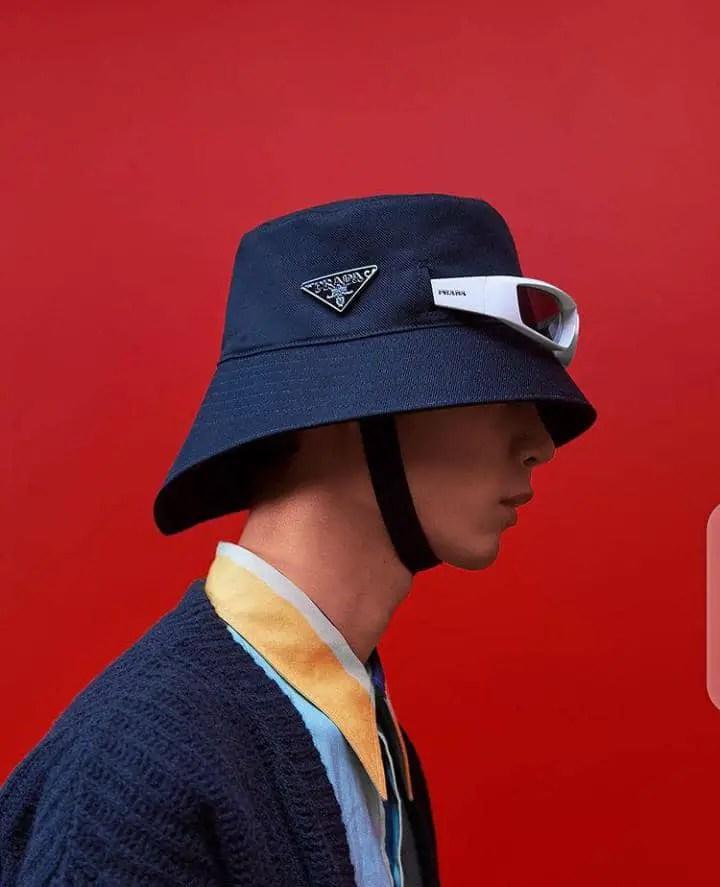 man wearing Prada cap and shades