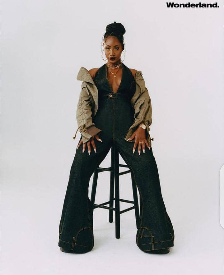Tems wearing jeans jumpsuit with jacket