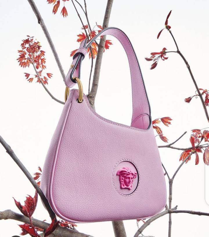 a pink bag by Versace