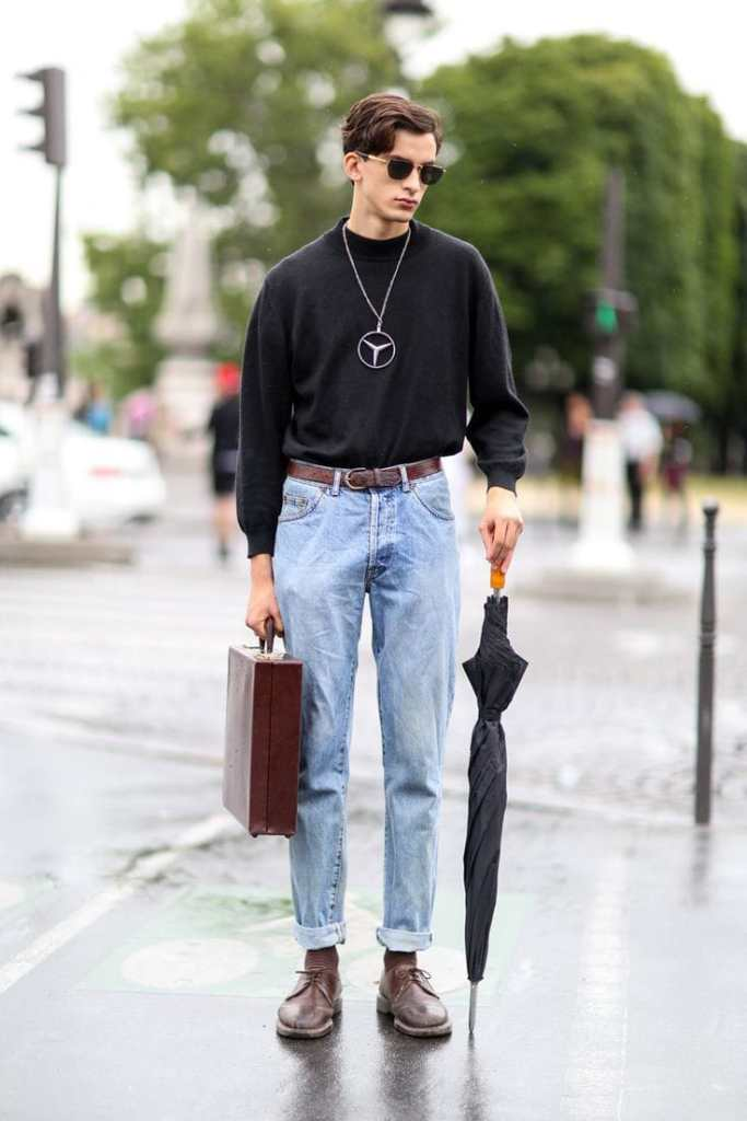 man wearing black Tee on ripped jeans