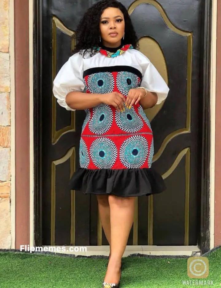 lady wearing wearing ankara dress and lace