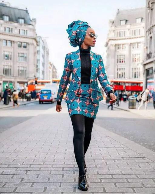 lady wearing ankara blazer with matching short skirt