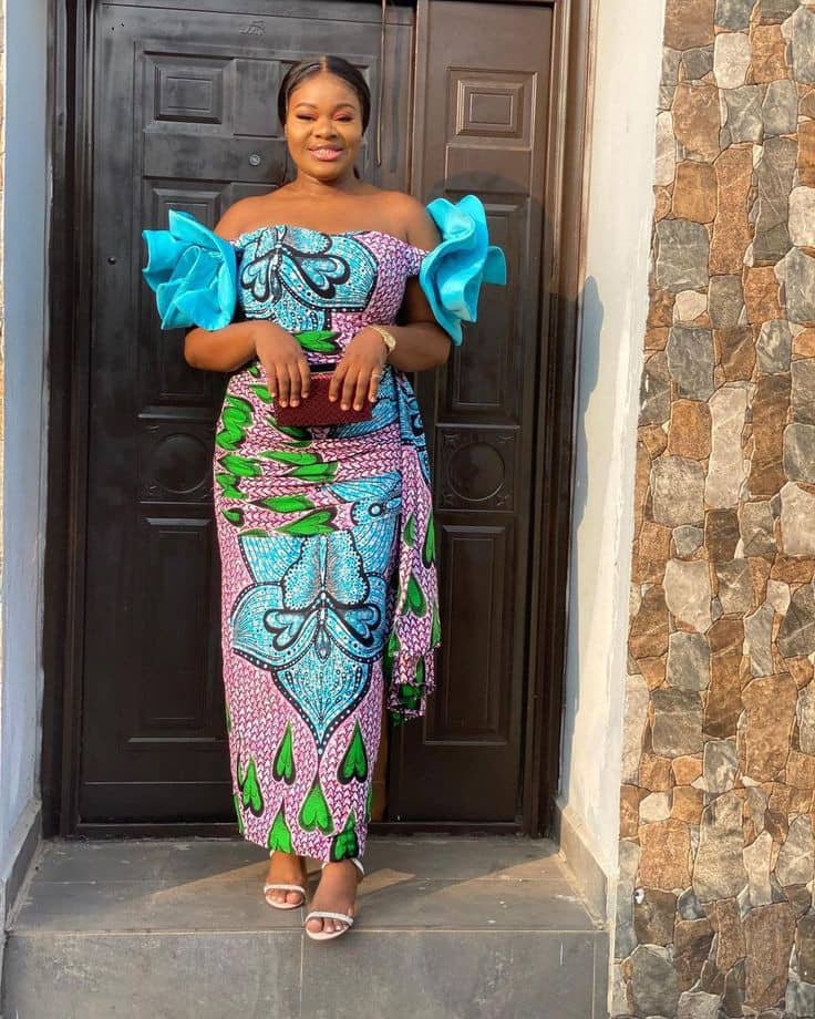 smiling lady wearing ankara long dress with a touch of blue chiffon