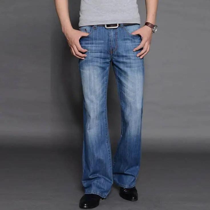 man wearing bootcut jeans