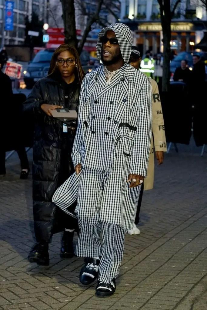 Burna Boy rocking eccentric suit with overcoat