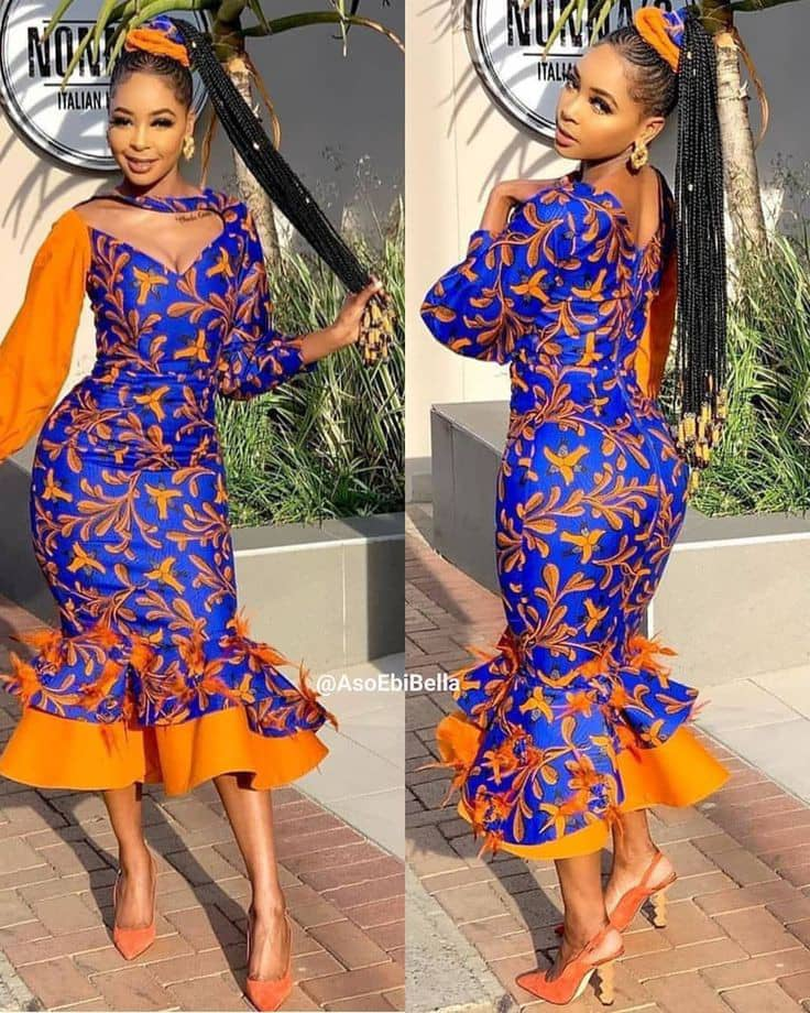 lady wearing ankara dress with a touch of orange organza material