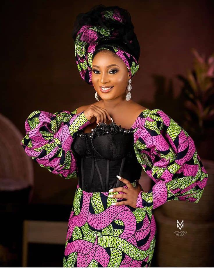 smiling lady wearing ankara dress with a touch of black net