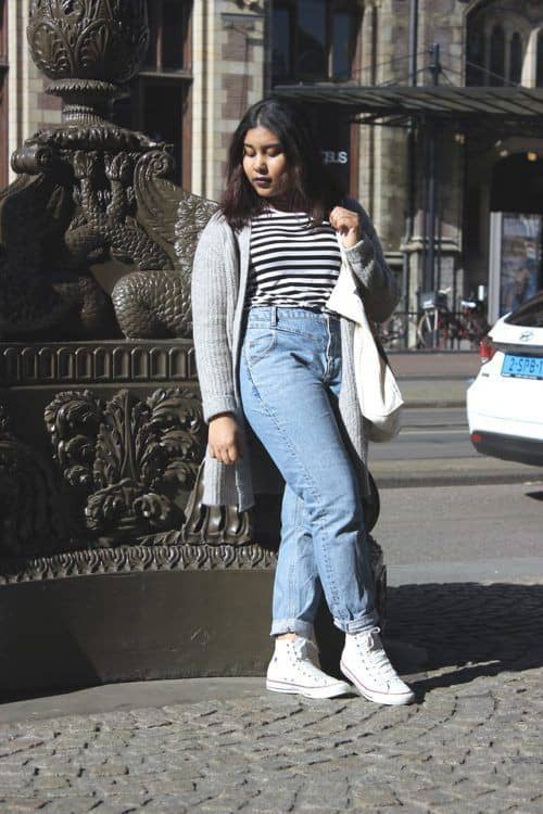 lady wearing layers on top with mom jeans
