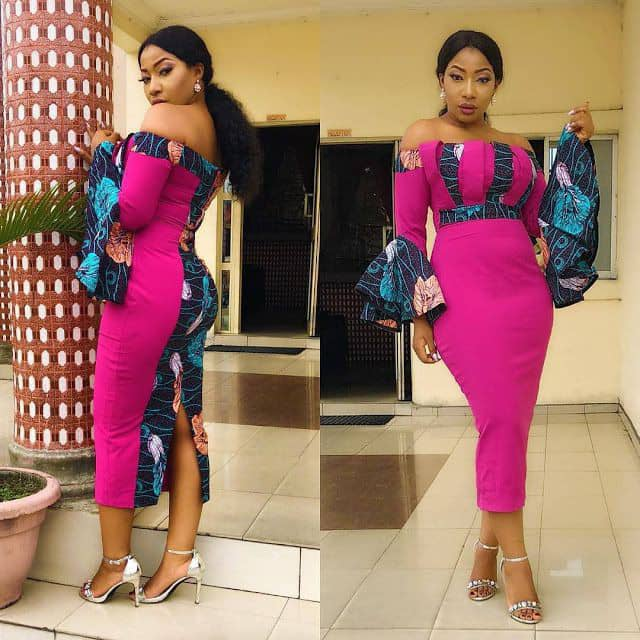 lady wearing plain material dress with touches of ankara