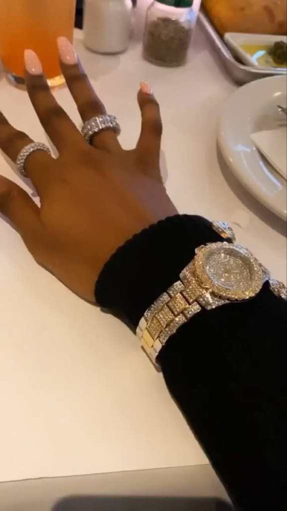 close up shot of hand with 2 rings and watch