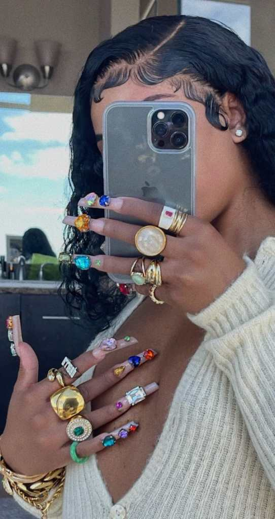 lady wearing multiple rings on all fingers