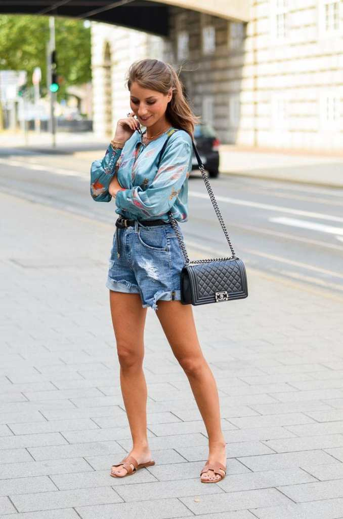 lady wearing top with jean shorts