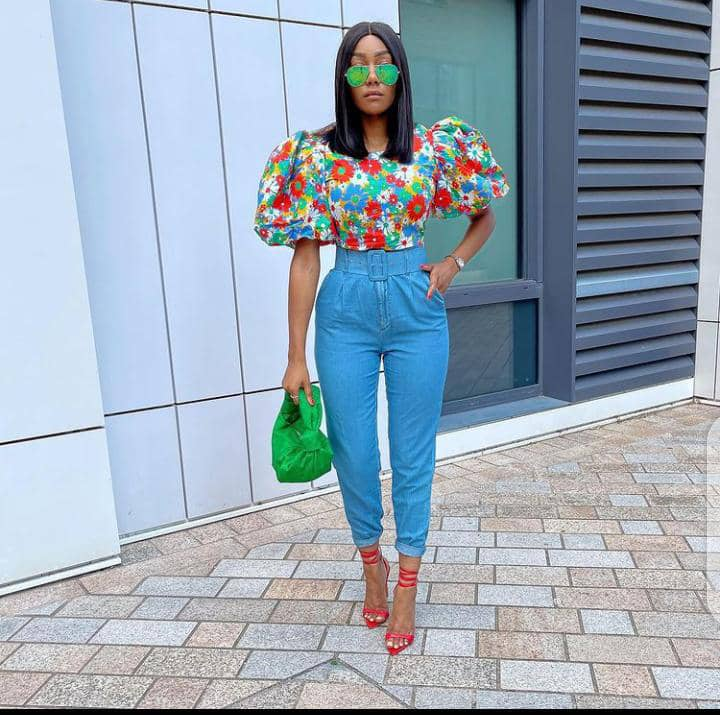 lady wearing top and jeans and heels
