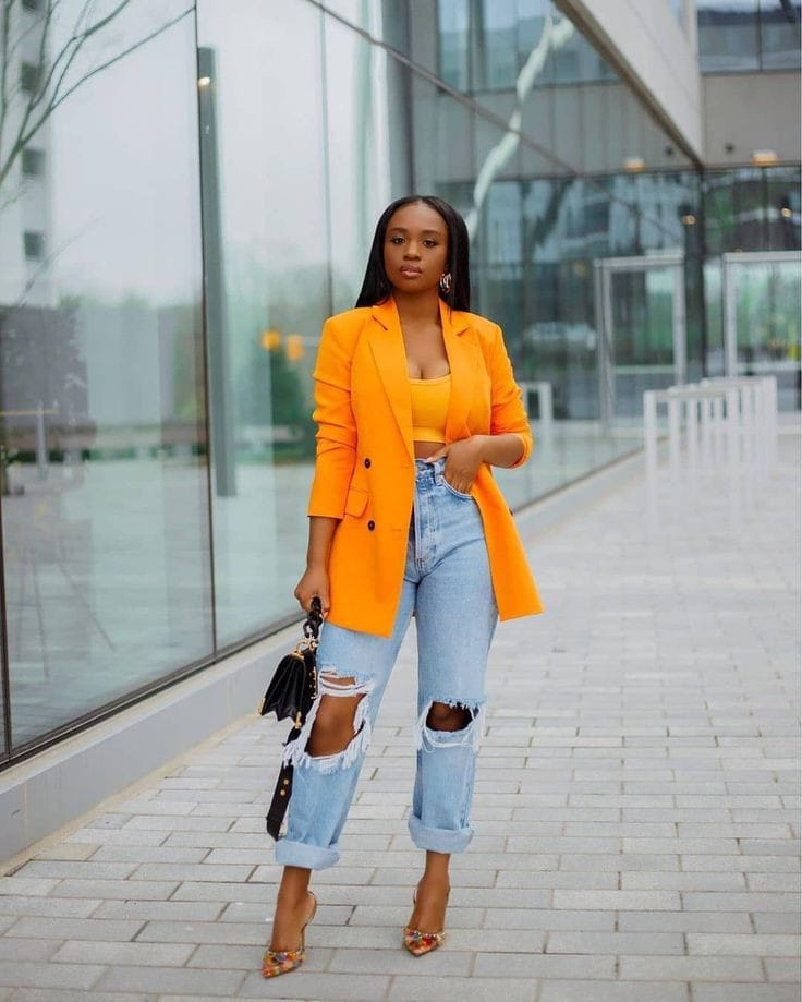 lady wearing yellow blazer with ripped jeans