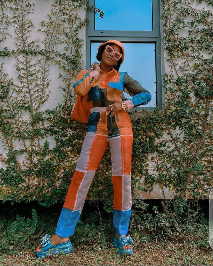 lady wearing multi colored patched outfit