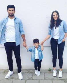 Modern Asian family wearing matching denim jackets and jeans