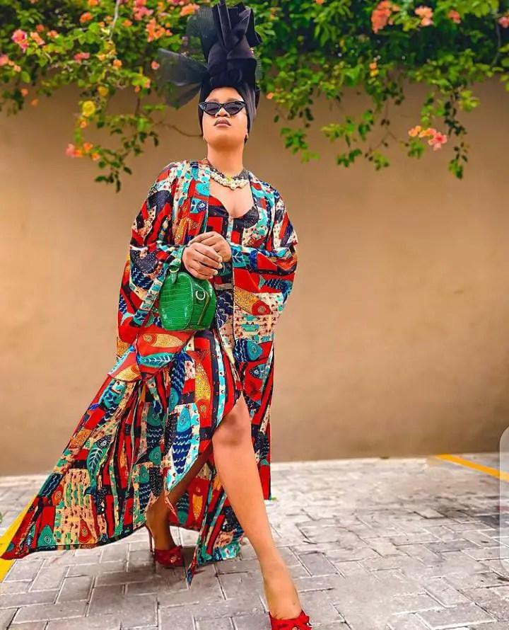 lady wearing loud colorful maxi dress