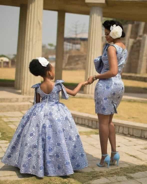 mother and daughter wearing matching fabric dresses