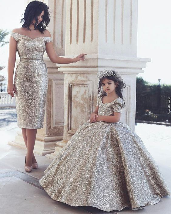 lady and daughter wearing matching dresses