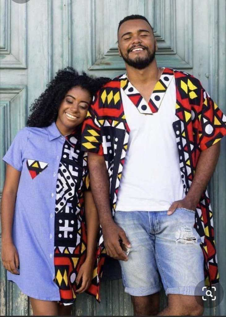 smiling couple wearing Afro-urban outfits