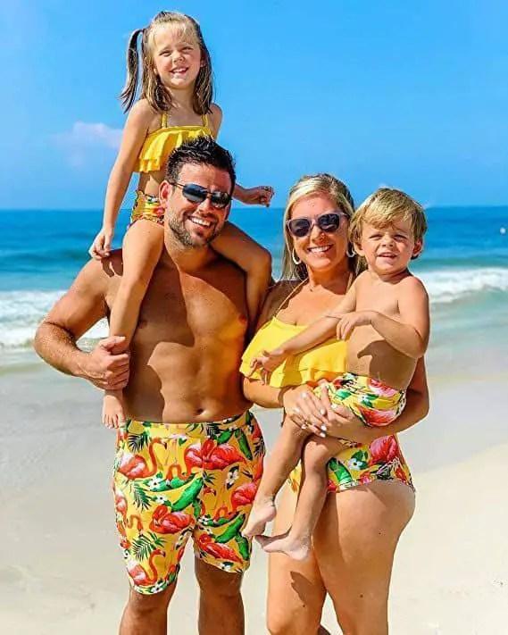 family wearing matching beach wear
