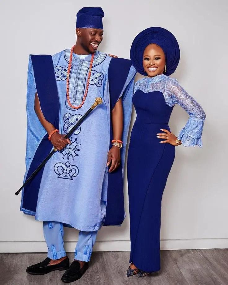 happy couple wearing matching native wears