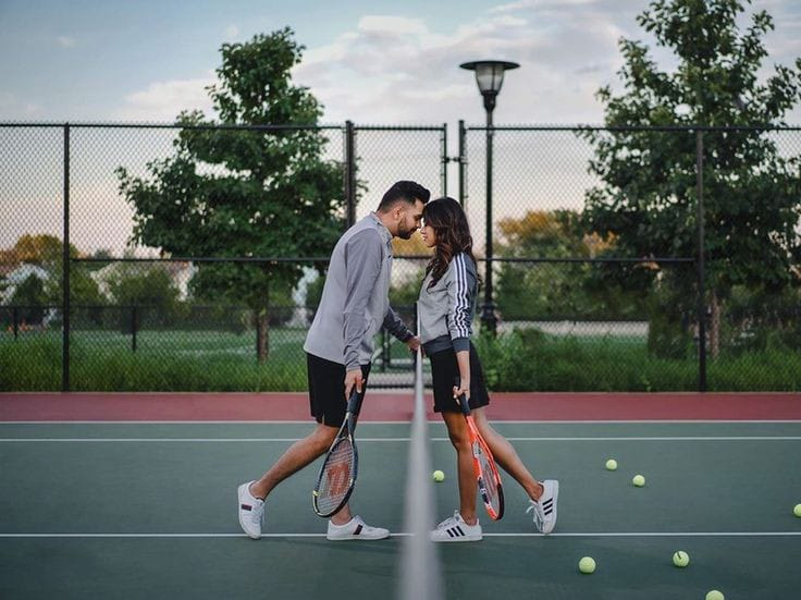 couple wearing matching tennis outfits to play tennis