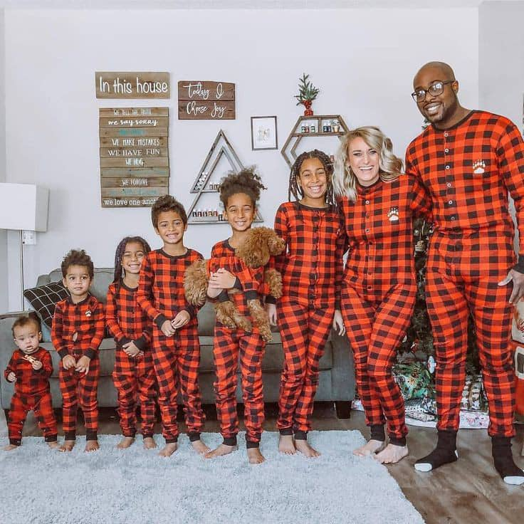 Black family wearing matching checkered clothes
