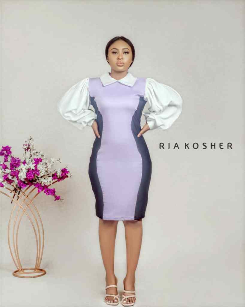 lady wearing ready-made dress by Ria Kosher
