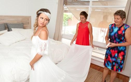 Putting on the wedding dress