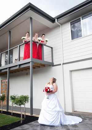 Bride looking up at Bridesmaids