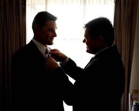Dad helping put on tie