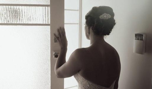 Bride looking out door