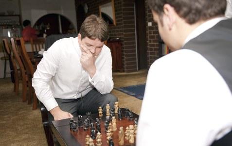 Groom playing chess