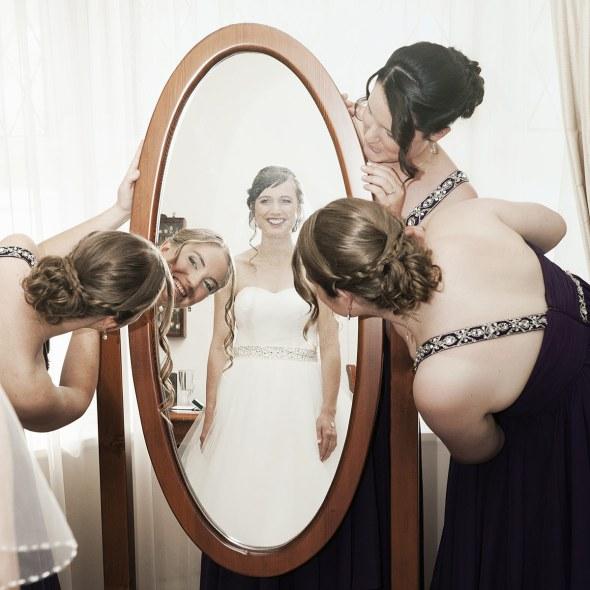 Looking at Bride in mirror