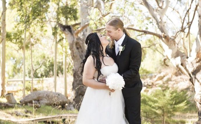 Bride and groom under gum tree