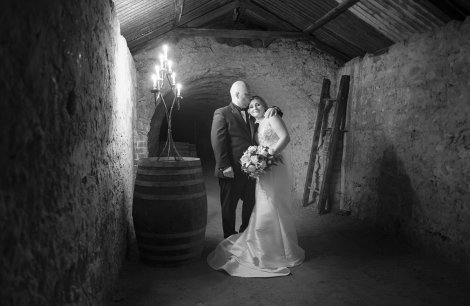Bride and groom in cellar