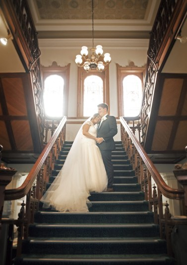 Bride and groom on stairway