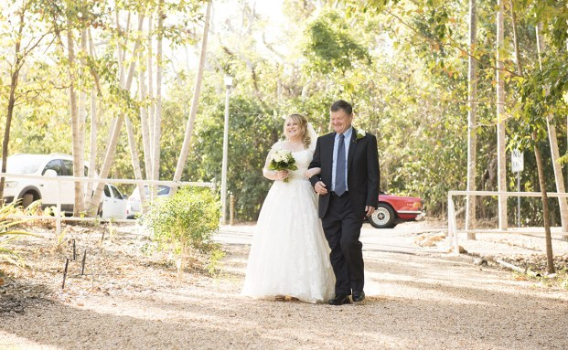 Bride and Father walking down ailse