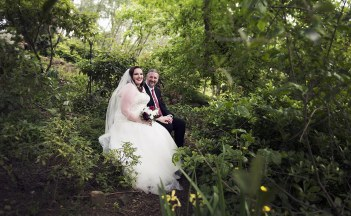 Bride and groom in garden