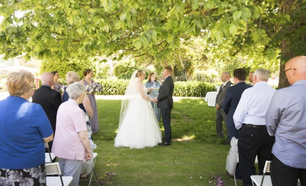 Bride and groom in front of guests