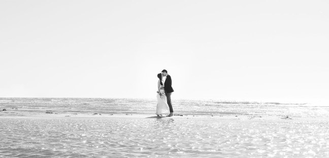 Embrace on sandbar