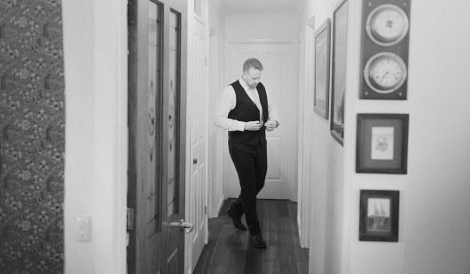 Groom walking the hallway