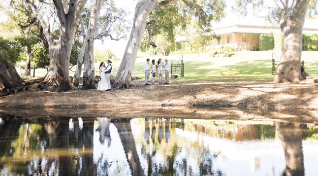 Bridal party on side of lake
