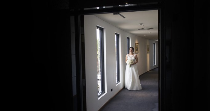 Bride walking down corridor