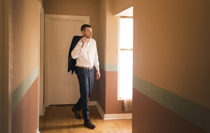 Groom walking out the door