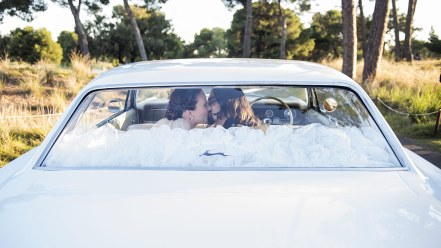 Backseat kissed for the bride and groom
