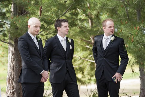 Groom standing about with groomsmen