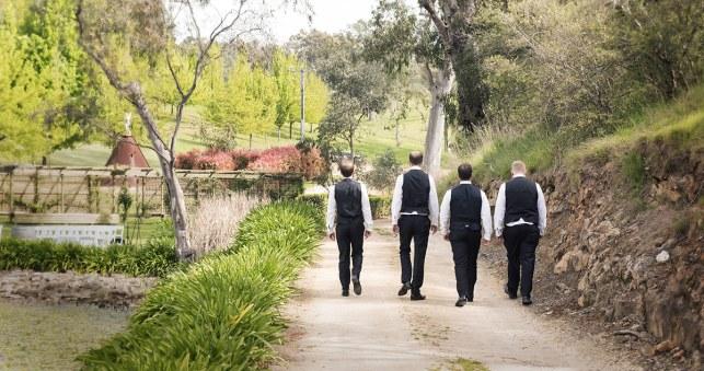 Boys walking along lake